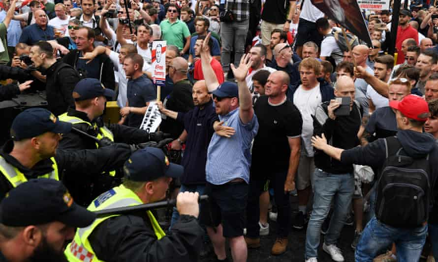 Tommy Robinson supporters march in London on Saturday.