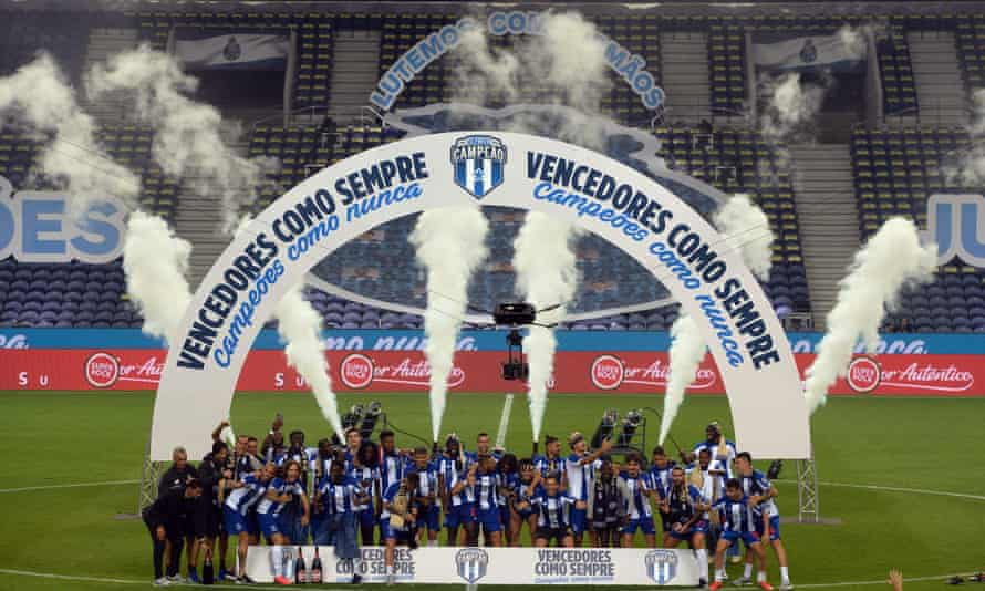 Porto players celebrate in style despite the lack of fans at their home ground.