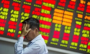 An investor reacts to plunging share prices at a stock exchange hall in Haikou, China.