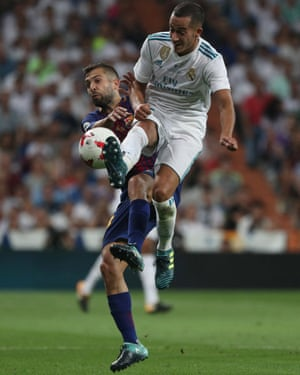 Real Madrid's Lucas Vazquez tussles with Barcelona's Jordi Alba.