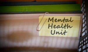Mental Health Unit written on document folder
