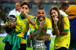 Alves celebrates with his children.