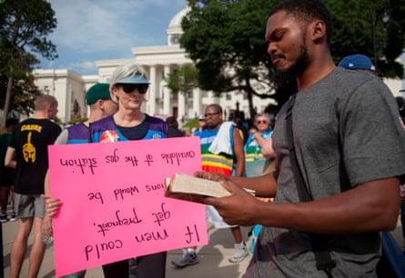 A pro-life supporter reads from the Bible near the March For Reproductive Rreedom rally outside the State Capital building in Montgomery, Alabama, May 19, 2019