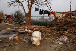 Delhi, India: A mannequin head on the banks of the Yamuna river