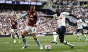 Tottenham's Tanguy Ndombele, right, attempts to get the better of Aston Villa's Conor Hourihane.