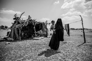 Nadia Mohammed Fadhl with her son, Mater, at the family's temporary shelter in the suburb of Bir Ahmed