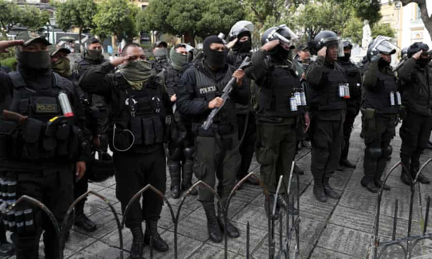 Police opponents of Morales sing the national anthem outside the presidential palace in La Paz, minutes before he announced his resignation.