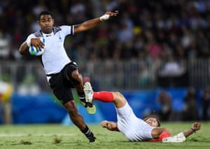 Vatemo Ravouvou leavesDan Bibby of Great Britain in his wake as Fiji win the men's rugby sevens gold medal.