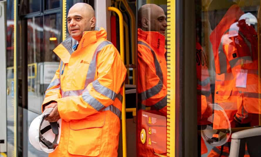 Sajid Javid steps off a tram during a visit to the Trafford Park Metrolink line in Manchester.