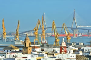 """""""Taking in the view of Cadiz, Spain, from the cathedral tower, I thought this forest of yellow cranes with the suspension bridge in the distance added a touch of modern art to the traditional architecture of this beautiful city."""""""