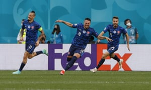 Slovakia's Robert Mak, center, celebrates with teammates.
