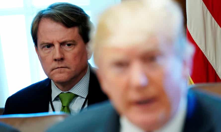 McGahn listens to Trump at a cabinet meeting in June 2018.