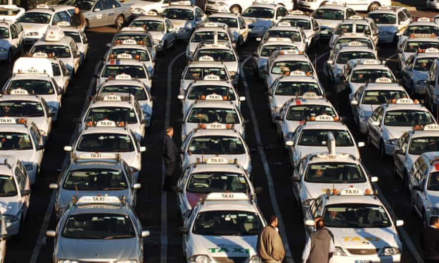 Taxis lined up waiting for fares at Sydney airport.