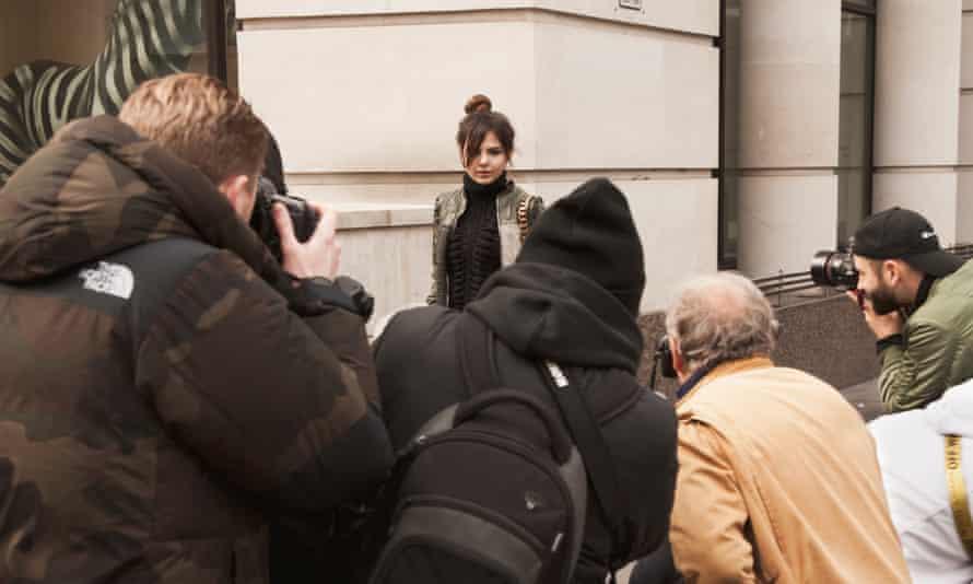 Doina greets photographers outside a London fashion week show.