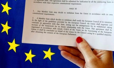 article 50 of the EU's Lisbon treaty and an EU flag.