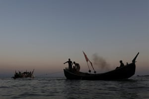 Rohingya refugees on an improvised raft are towed across the Naf river to reach Bangladesh.