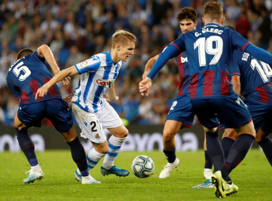 Martin Odegaard (L) tries to get the better of a clutch of Levante players while with Real Sociedad last season.
