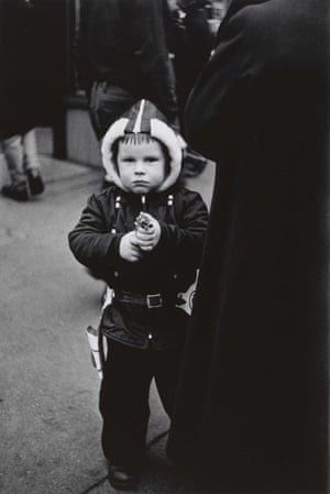 Kid in a hooded jacket aiming a gun, NYC, 1957