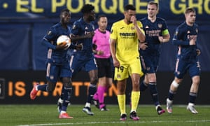 Villarreal's Francis Coquelin looks dejected as Nicolas Pepe celebrates after pulling a goal back for the visitors.