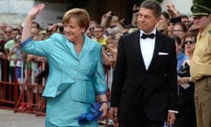 Angela Merkel and her husband, Joachim Sauer, arrive at a concert