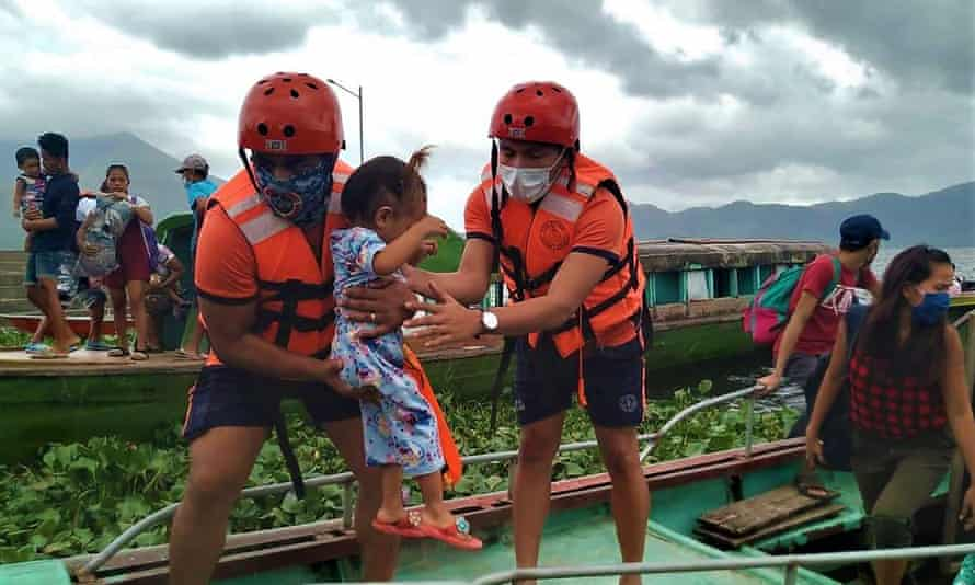 Residents are evacuated from coastal villages in Buhi town, Camarines Sur province, south of Manila ahead of Typhoon Goni's landfall.