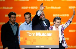 Canada's New Democratic Party leader Tom Mulcair waves with his wife Catherine and sons Greg and Matthew after he gave his concession speech in Montreal.