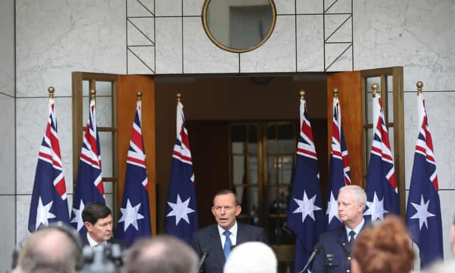 Abbott at a press conference in 2015 backed by eight Australian flags. Despite his campaign against the 'death cult' it 'never actually translated into some long-term basis for support of government', Markus says.