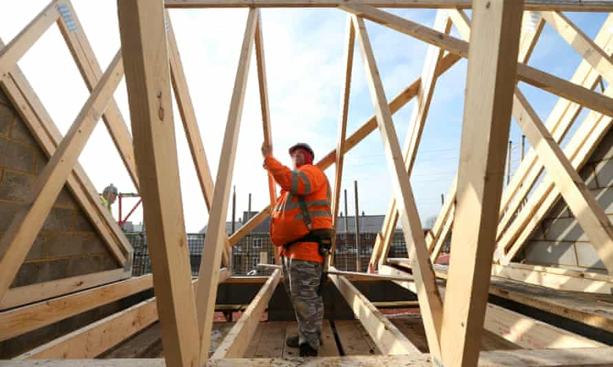A builder assembles wooden roofing joists on a new home at a Barratt construction site in Bedford. Barratt homes were on average 6.7sq m smaller than minimum space standards