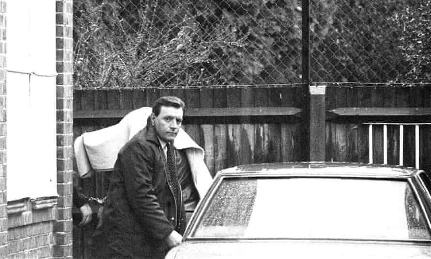 A handcuffed figure, covered with a blanket, at Feltham magistrates court, London. The unidentified figure is presumed to be Brian Robinson.