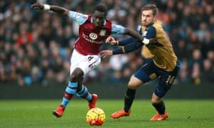 Aston Villa's Idrissa Gueye on the attack passing Aaron Ramsey.