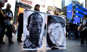 Aliya Donn (left) and Mia Robbins hold pictures of Kalief Browder (left) and Christopher Robinson, who both died as a result of alleged official misconduct related to Rikers Island jail.