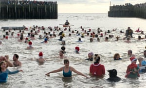 Swimmers and spectators at the Boxing Day West Bay Wallow.