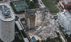 Search and rescue personnel work after the partial collapse of the 12-story Champlain Towers South condo building in Surfside, Florida.