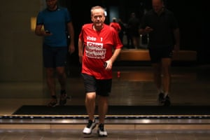 Bill Shorten starts election day with an early morning run in central Melbourne while wearing his campaign pitch on his T-shirt.