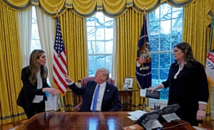 With President Donald Trump and White House Press Secretary Sarah Sanders in the Oval Office