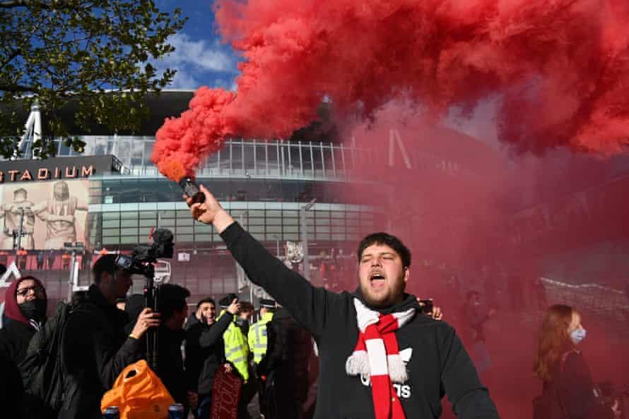 Arsenal fans protest against owner Stan Kroenke outside the Emirates Stadium