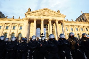 Police stand in front of the Reichstag building after demonstrators tried to climb the stairs after a protest against coronavirus pandemic regulations in Berlin, Germany, 29 August 2020.
