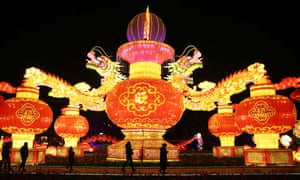 Tourists watch a light show at World Horticultural Expo Garden in Kunming, China.