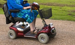 Disabled Woman On Scooter
