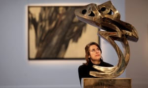 A gallery assistant for Sotheby's views a sculpture, Standing Heech Lovers.