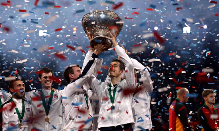 Andy Murray lifts the trophy with his team-mates after Great Britain's historic victory.