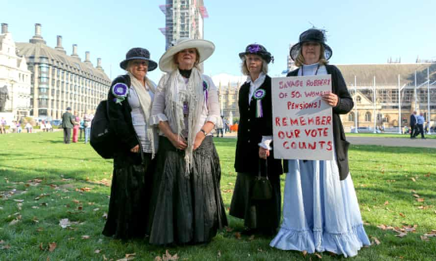 Four women in suffragette costumes