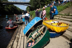 Coracle boats sit stacked beside the River Severn at the Ironbridge Coracle Regatta