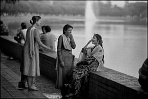 Sex workers share a joke beside Crescent Lake in the grounds of the house of parliament in Dhaka,  Bangladesh, 1996