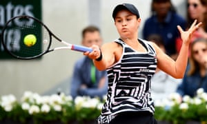 Ashleigh Barty bashes a return to Amanda Anisimova.