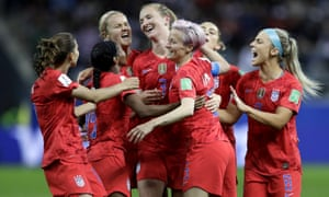 United States' scorer Samantha Mewis (centre) and her teammates celebrate their fourth goal.