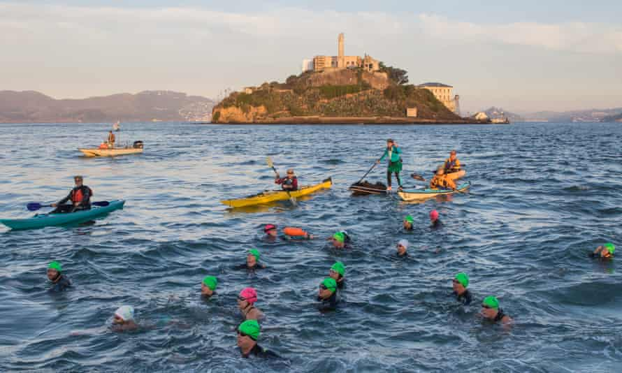 The pull of the Rock … swimmers during a November crossing from Alcatraz Island to San Francisco.