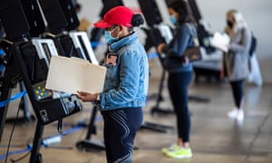 Washington DC residents use voting machines at the polling place inside Union Market, 2 November 2020.