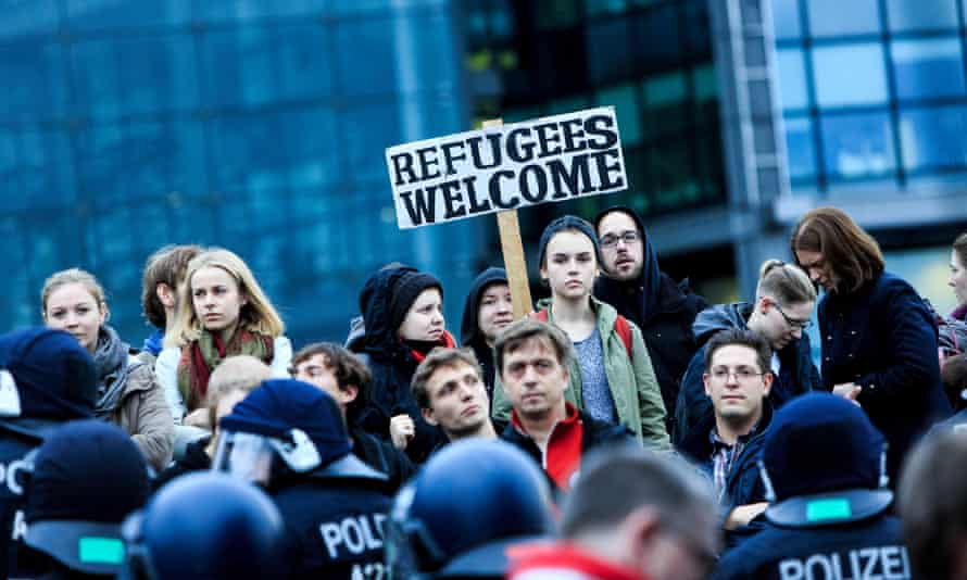 Demonstrators in Berlin hold a 'Refugees Welcome' sign in November 2015.