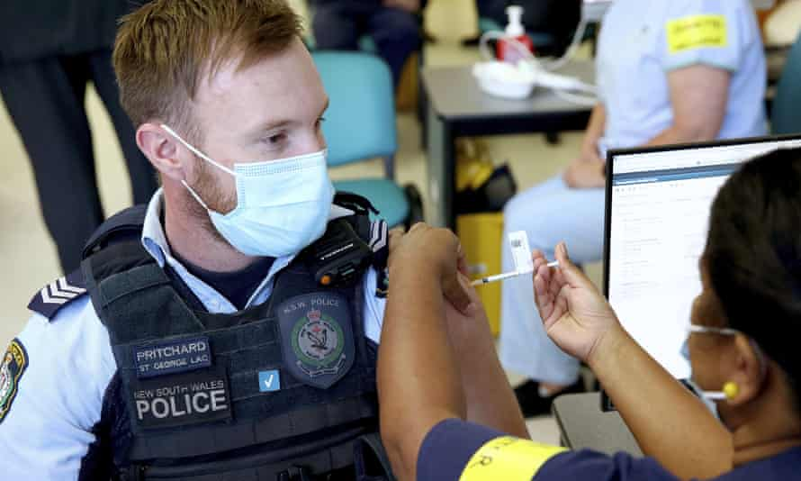 NSW police officer Lachlan Pritchard receives the Pfizer vaccine at the Royal Prince Alfred hospital vaccination hub in Sydney on Monday.